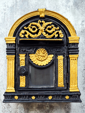 Vintage Gold and Black Mailbox Hanging on the White Wall 免版税图像