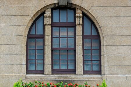 Beautiful Arched Colonial Window of Taipei Post Office, Taiwan Stock Photo