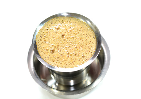 Madras: Madras filter coffee is famous coffee in India. Coffee is prepared with roasted coffee powder, milk and sugar. It is served hot in stainless steel cup Stock Photo