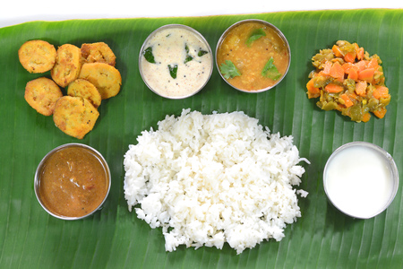 Indian lunch food served in green banana leaf. Stock Photo