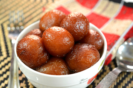 gulab: Gulab Jamun is an Indian dessert made out of condensed milk balls and sugar. They are fried and soaked in sugar syrup. It is a popular Indian sweet dish prepared during Indian festival Diwali,