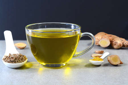 Cumin tea also known Jeera tea or Jeera water in a glass cup with cumin seeds in a spoon Stock fotó - 152483616