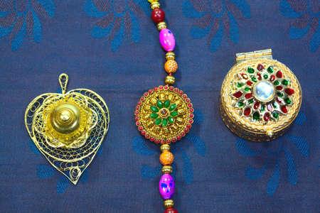 Celebrating Indian festival Raksha Bandhan. Colorful rakhi with stones on silk background Stock fotó - 152483620