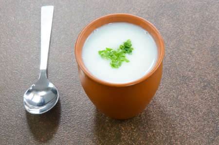 Buttermilk in a pot cup garnished with parsley