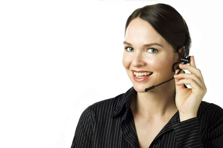 Friendly smiling telephone operator/secretary with headset over white Stock Photo - 6002481