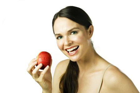 Young attractive woman smiling and holding an apple. Isolated over white Stock Photo - 6005372