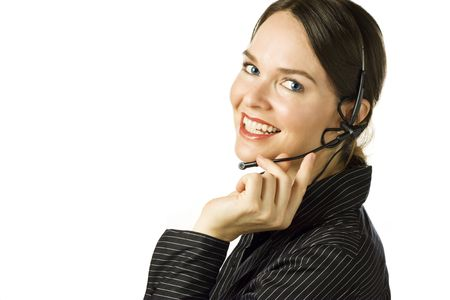 Beautiful customer service agent smiling during phone conversation. Isolated over white.