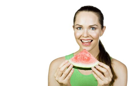 Attractive woman eating a watermelon and smiling. Isolated over white. Stock Photo - 6067410
