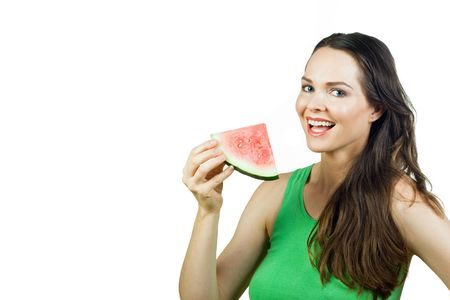 Beautiful young woman holding slice of watermelon and smiling. Isolated over white. Stock Photo - 6067411