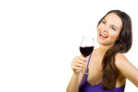 Beautiful young brunette laughing and holding a glass of red wine. Isolated over white photo
