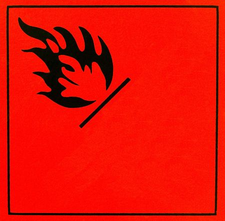 flammable: An orange flammable warning sign