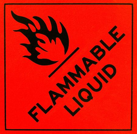 An orange flammable liquid warning sign with black writing Stock Photo - 6582012