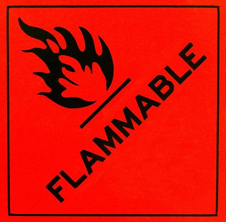 An orange flammable warning sign with black writing Stock Photo - 6582011