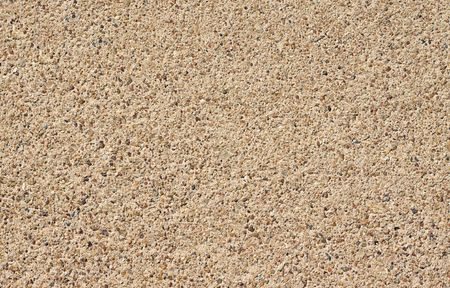 A seamless rough pebble concrete footpath or sidewalk background Stock Photo