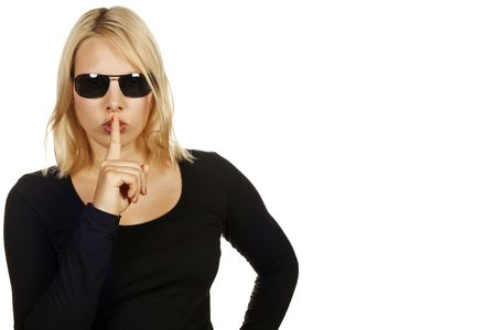 Portrait of an attractive cool blonde girl hushing. Isolated over white. Stock Photo - 7107814