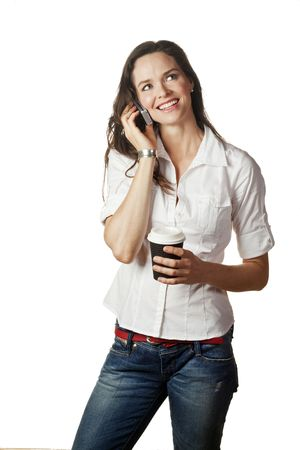 A great portrait of an attractive casual young woman talking on her mobile and holding a take away coffee Stock Photo - 7221361
