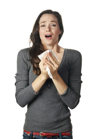 An attractive woman with hay fever or a cold sneezing into tissue Stock Photo - 7219553