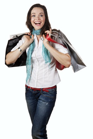 A very beautiful, casual and happy girl holding shopping bags and laughing. Isolated on white. Stock Photo - 7281290