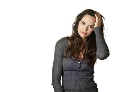 confused woman: Strong image of a very tired, stressed and fed up attractive woman. Isolated over white.