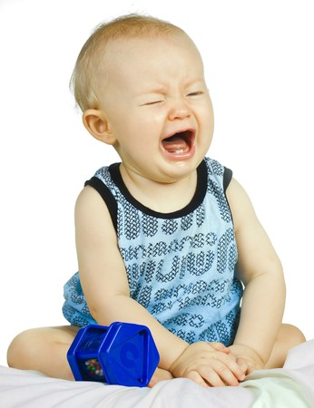 A cute but very upset baby boy crying.  Stock Photo