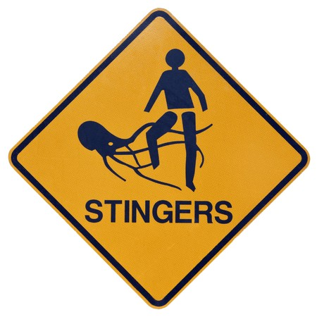 stingers: A yellow and black warning sign for dangerous marine stingers or jellyfish in tropical Australia.
