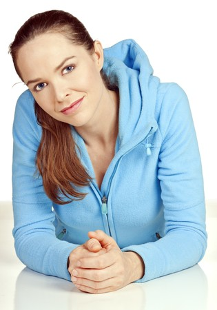 A beautiful young woman relaxing on the floor wearing a jumper and looking at camera.  photo