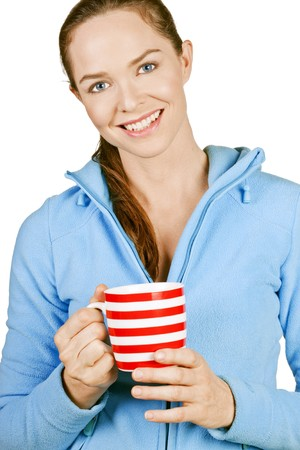 Portrait of a beautiful young smiling woman holding a cup of coffee or tea. Isolated over white. photo