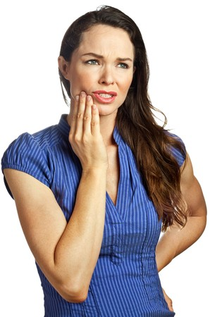 Isolated portrait of an attractive young woman suffering from toothache