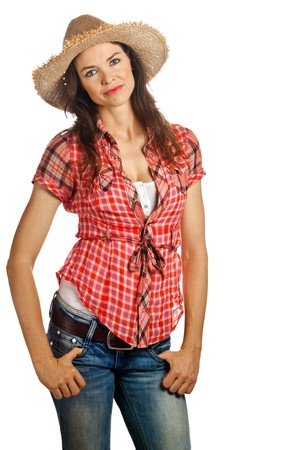 An isolated portrait of a beautiful young cowgirl with attitude photo