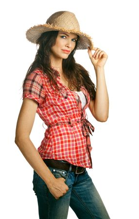 tomboy: An isolated portrait of a beautiful young cowgirl with attitude holdinh her hat. Isolated over white.