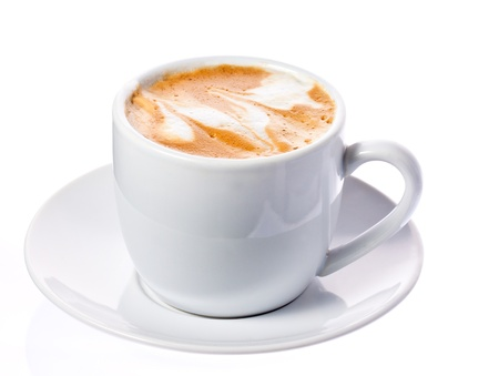 A delicious cup of freshly made cappuccino or macchiato on a white saucer