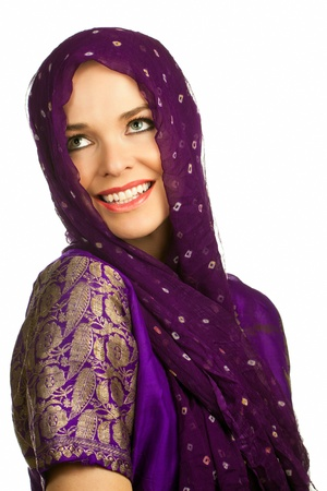 Isolated portrait of a beautiful smiling indian woman in traditional clothing and head scarf photo
