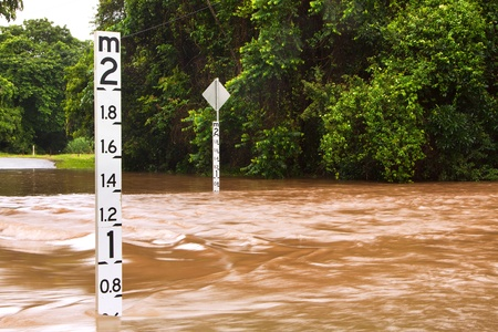 A flooded road with depth indicators in Queensland, Australia Stock Photo - 8697776