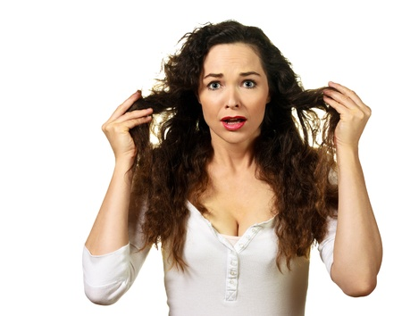 Isolated portrait of a beautiful young woman having a bad hair day Stock Photo - 9255136