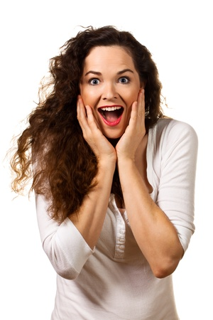 Beautiful young surprised woman looking at camera. Isolated over white. Stock Photo
