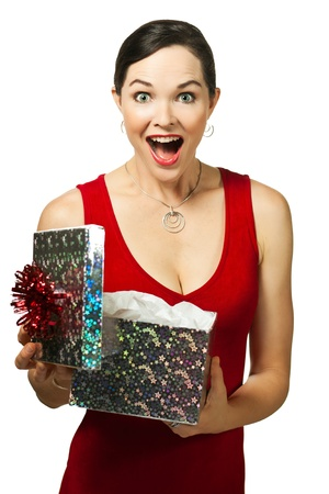 Beautiful young woman opening gift box looking very excited Stock Photo