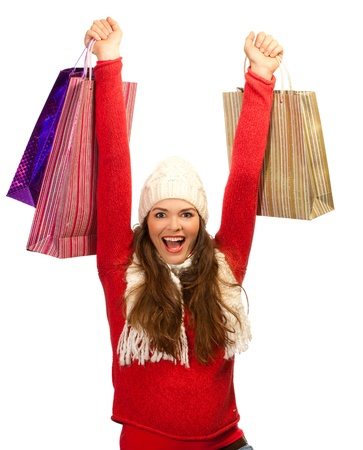 A beautiful young woman out shopping is thrilled to find the perfect Christmas gift photo