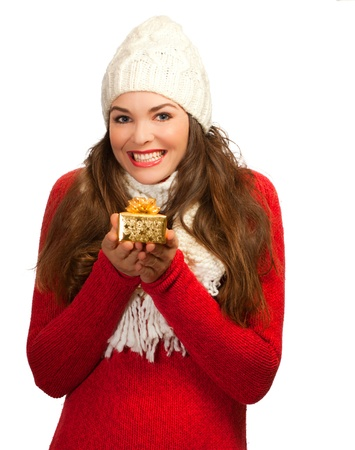 beautifully wrapped: A beautiful young woman smiling and holding a small beautifully wrapped Christmas present. Isolated on white.