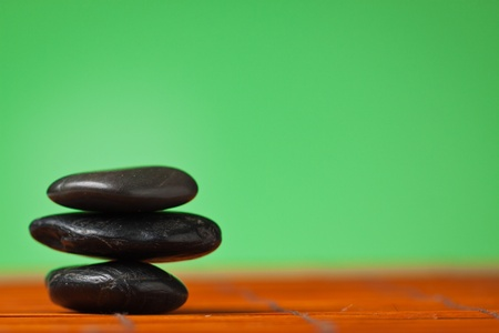 Stack of balancing black stones: background with lots of copy-space