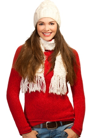 Isolated portrait of a young smiling beautiful woman wearing warm winter clothes. photo