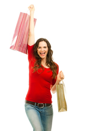 Beautiful young woman very happy with successful Christmas shopping photo