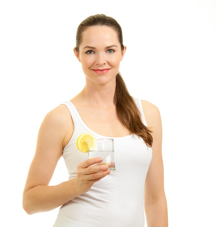 lemon water: Young beautiful smiling woman holding a glass of water with slice of lemon. Isolated over white.