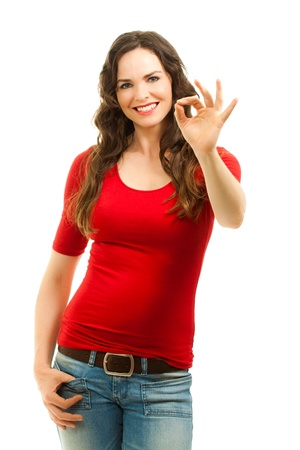 Isolated portrait of a beautiful young happy woman making an ok sign with her fingers photo