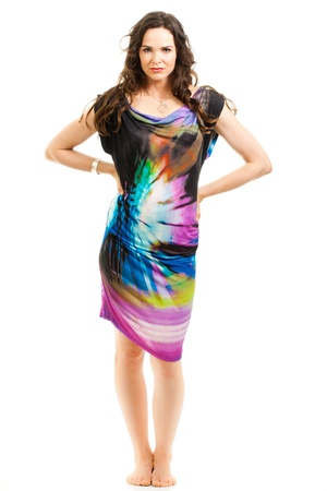 foot model: Portrait of a beautiful sexy woman wearing a colorful dress. Stock Photo