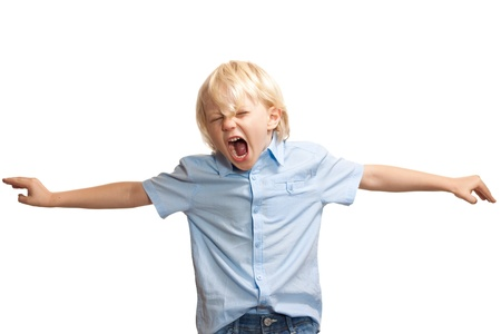 hyperactivity: A loud and screaming young boy trying to get attention Stock Photo