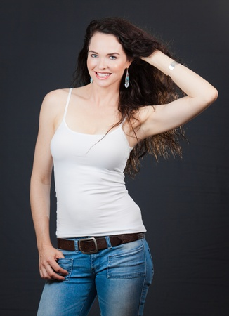 women jeans: Portrait of a pretty young woman holding her hair Stock Photo