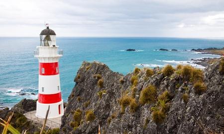 Beautiful lighthouse and coastline at Cape Palliser, North Island, New Zealand photo