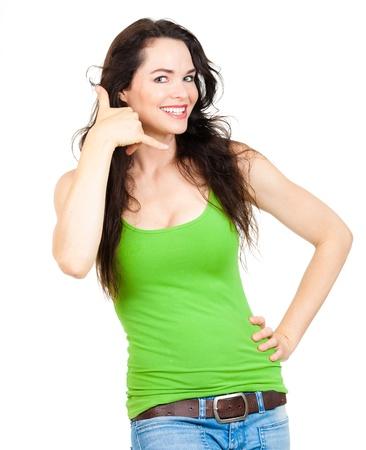 to gestures: Una hermosa mujer joven feliz sonriendo y symboling Foto de archivo
