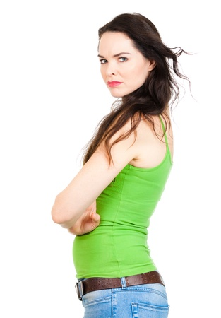 looking over shoulder: A jealous unhappy beautiful young woman looking over her shoulder at someone  Isolated over white Stock Photo