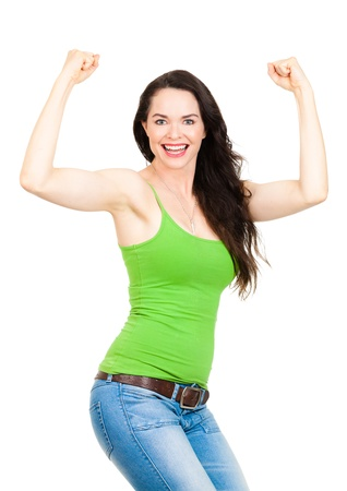 A happy beautiful fit woman felxing her muscles and smiling  Isolated over white  photo